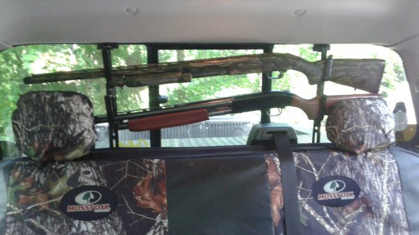 two shotguns in truck gun rack